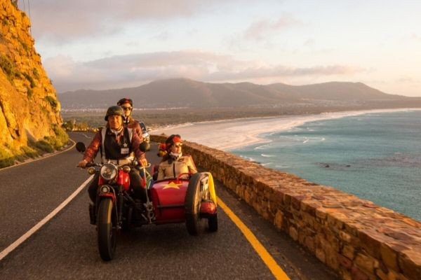 People going on a sidecar adventure on Chapman's Peak